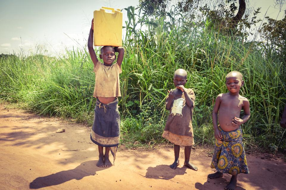 ugandan-children-carrying-water-home-photo-copyright-protected-by-dora-leticia-limited-use-only-with-written-permission-required-no-extended-use
